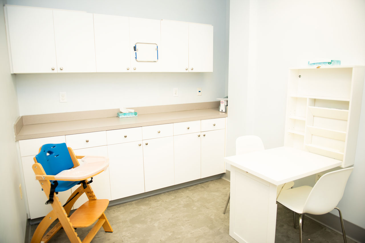 office with consultation desk and wooden highchair at Carolina Therapeutics Fort Mill SC office