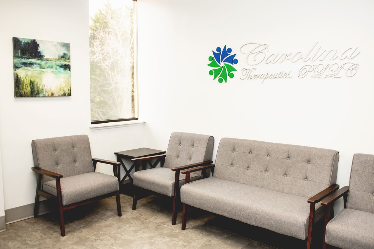 Carolina Therapeutics Fort Mill, SC office waiting room with soft grey chairs