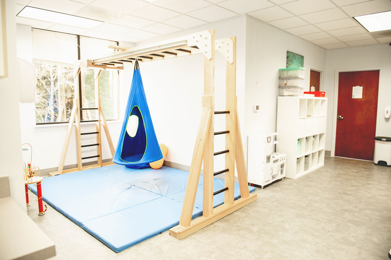 Carolina Therapeutics occupational therapy room with blue and wooden equipment