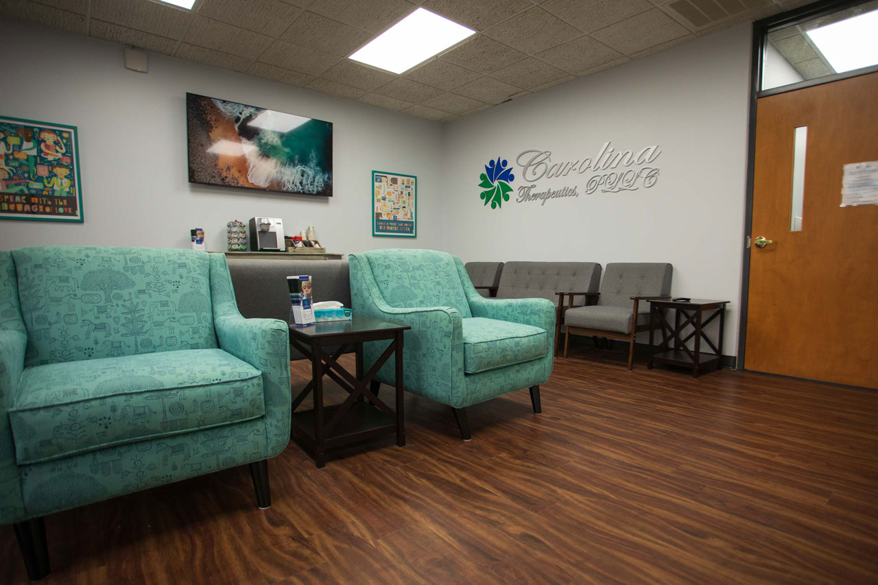 Carolina Therapeutics Greenville, NC waiting room with plush green and grey chairs